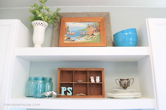 floating shelves above the sink in our last flip house | The Harper House