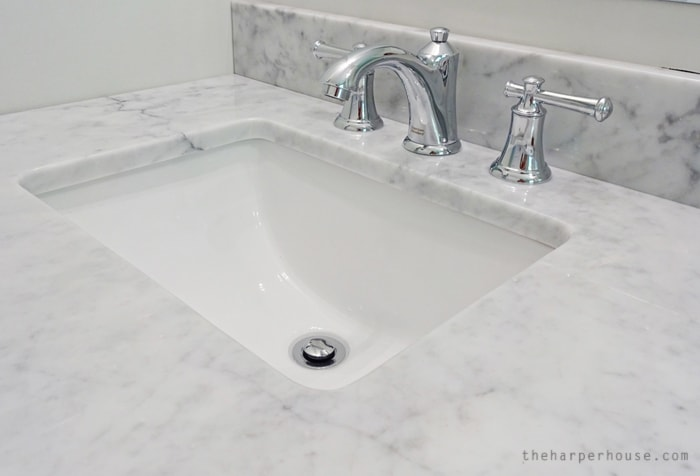 Get the look of expensive fixtures for SO much less. These faucets are gorgeous and add just the right amount of classic style to our DIY bathroom remodel. Find the sources on the blog: www.theharperhouse.com