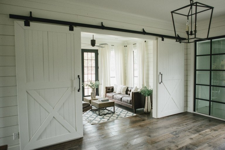 If you love sliding barn doors, you'll love this roundup of 10 Awesome Sliding Barn Door Ideas. What a perfect way to add Fixer Upper Style to your home just like Joanna Gaines| www.theharperhouse.com