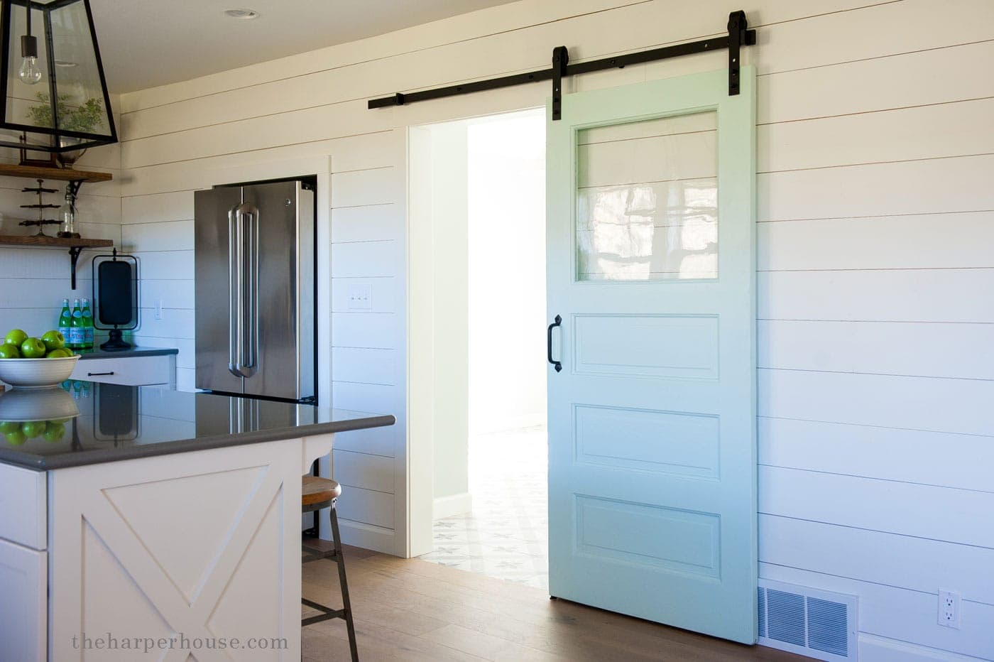 sharing our fixer upper farmhouse kitchen reveal featuring a barn door white shaker cabinets : reveal door - pezcame.com