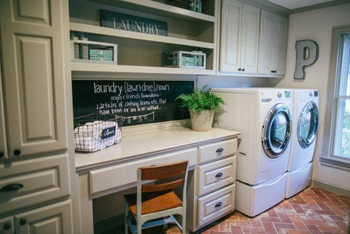 Fixer Upper laundry mudroom with desk and pantry storage, via Joanna Gaines