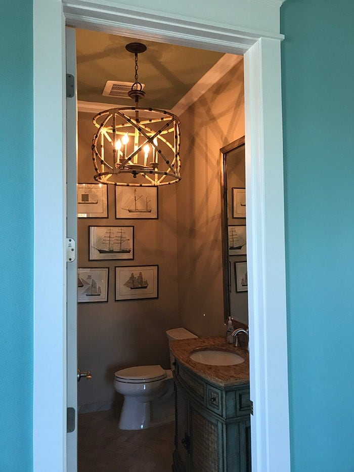 powder room with amazing light fixture!