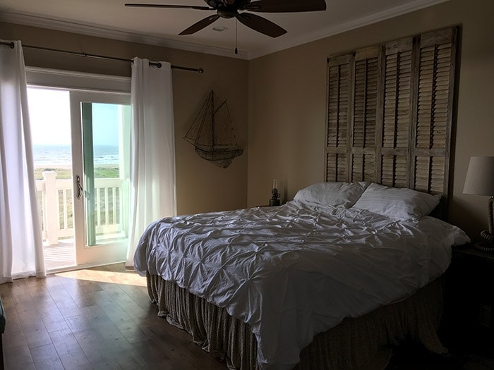 beach house master bedroom with balcony overlooking the gulf