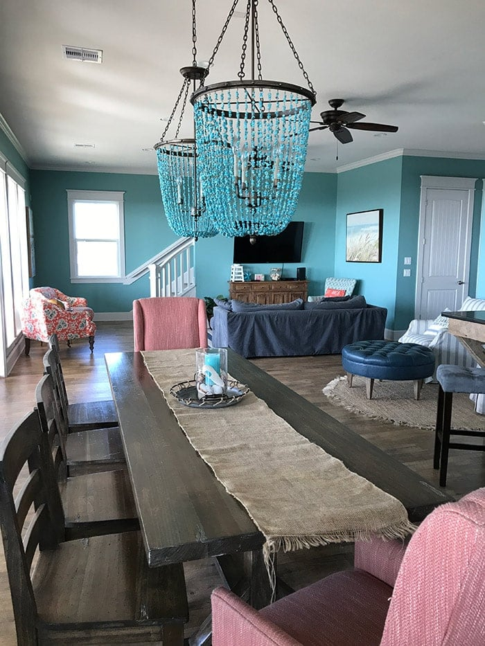 coastal beach house in Galveston, TX with farmhouse table and amazing light fixtures