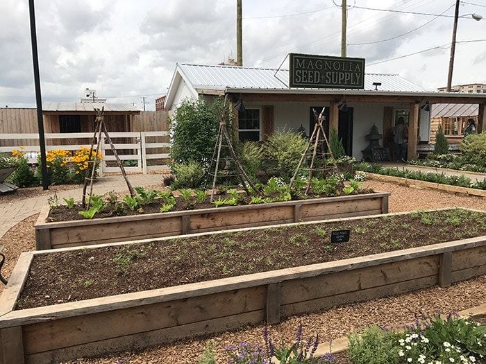 Our trip to the Magnolia Silos. Sharing cute outdoor gardening ideas I found at Magnolia Market. Raised beds, vegetable gardening ideas, outdoor flower garden, organic gardening, Fixer Upper