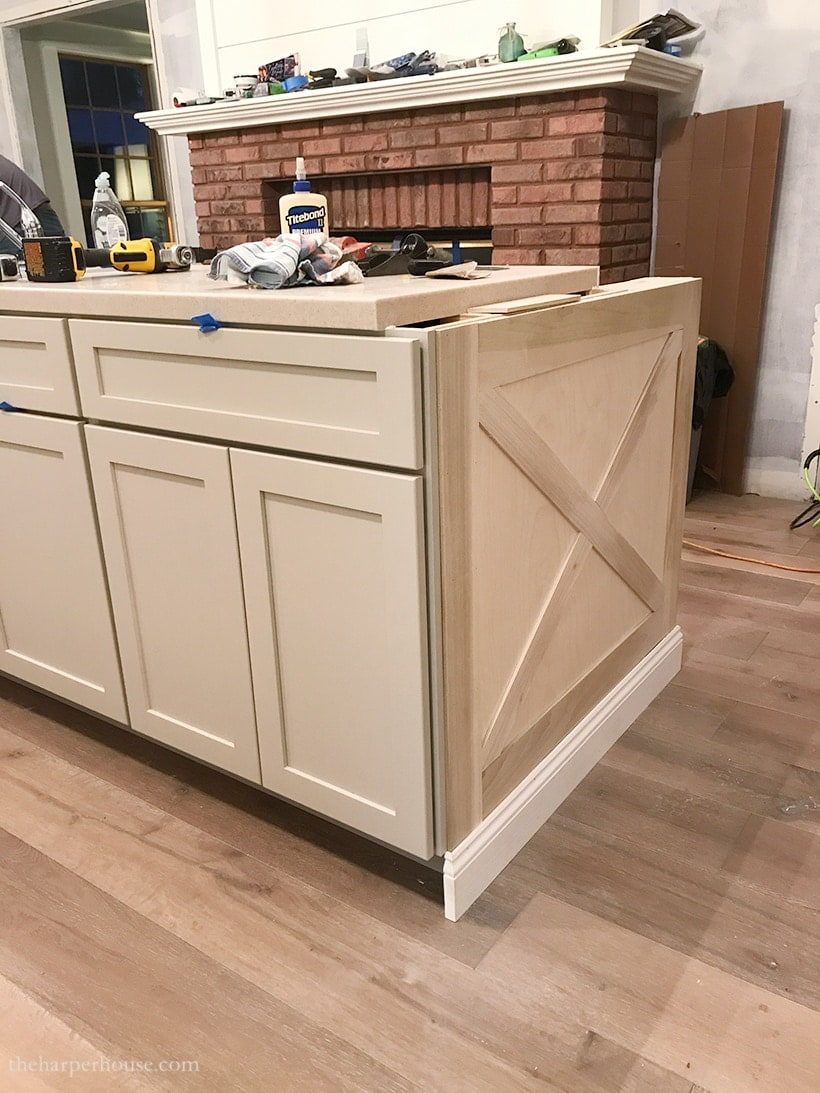 Adding diy kitchen island trim to basic builder grade cabinets | kitchen island ideas | modern farmhouse kitchen | coastal kitchen | diy kitchen renovation www.theharperhouse.com