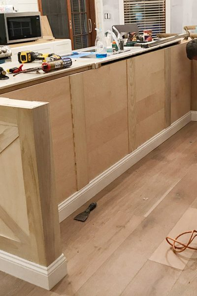 Adding diy kitchen island trim to basic builder grade cabinets | kitchen island ideas | modern farmhouse kitchen | coastal kitchen | diy kitchen renovation www.theharperhouse.com