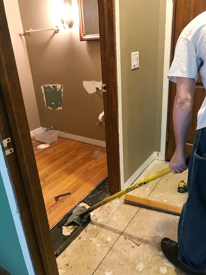 removing wood floor | powder bathroom remodel #bathdesign #bathroomremodel