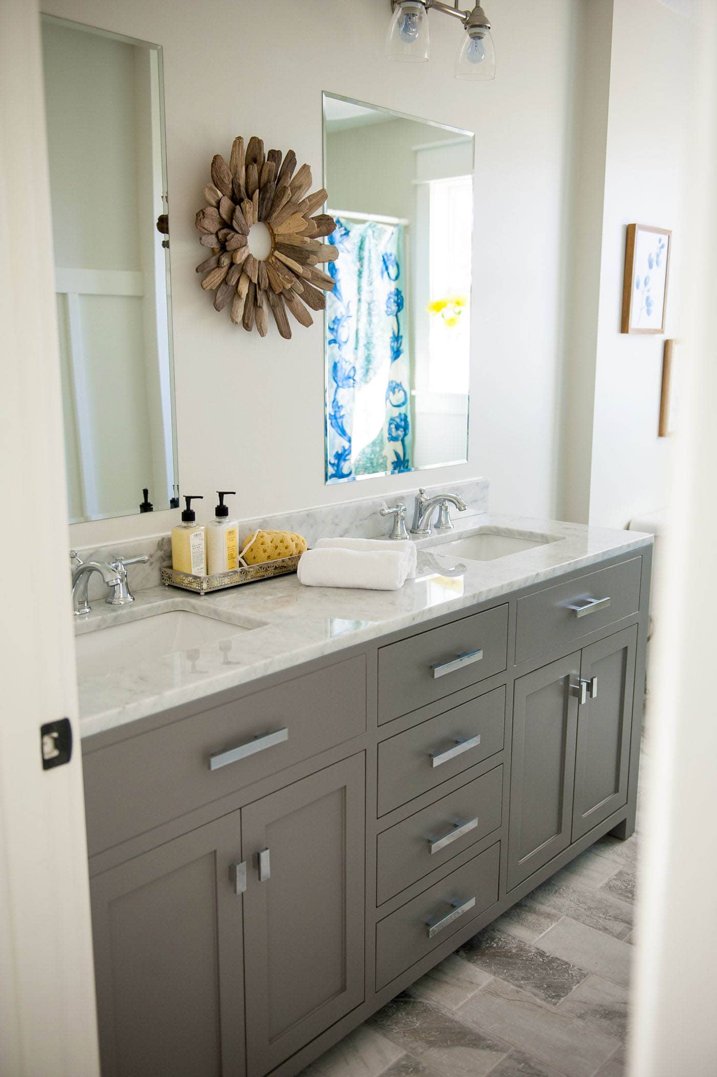 gray bathroom vanity, find out where to buy this exact vanity online. Click to see our bathroom vanity shopping guide and full resources on the blog. bathroom vanity ideas | double sink vanities | bathroom renovation | bathroom remodel | farmhouse bathroom | master bath remodel #bathroomdecor #bathroomidea #bathroomdesigns