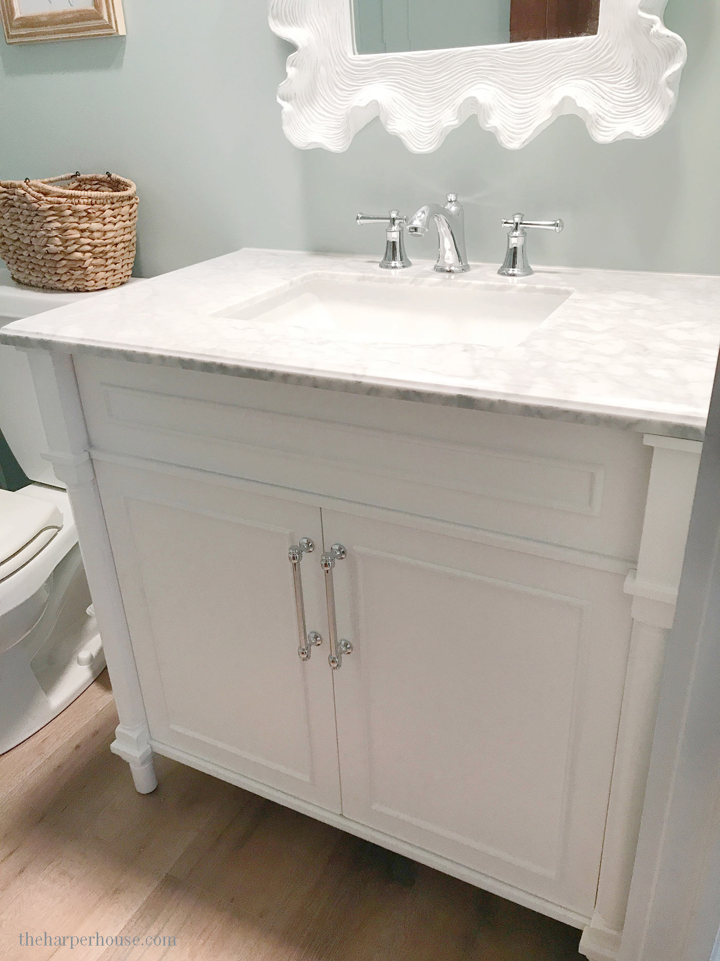 This gorgeous vanity is half the price of a custom piece! See where to purchase on the blog. Get the look for less and save money with budget friendly bathroom design ideas. Bathroom Vanities Single Sink | Bathroom Decorating Ideas | Bathroom Remodeling Ideas | Farmhouse Bathroom | Bathroom Cabinets #bathroomidea #bathroomdesigns #bathroomdecor #bathroomremodel