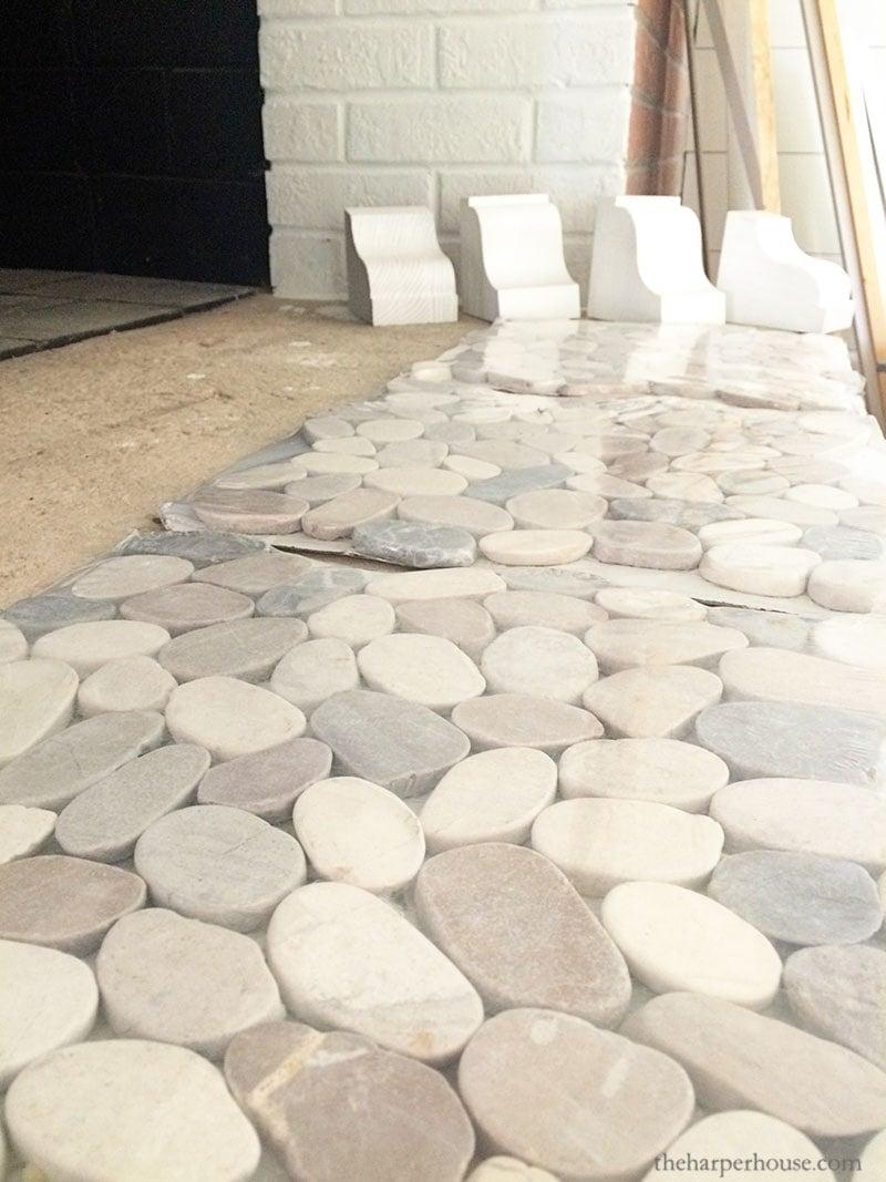 brick fireplace makeover using pebble stone mosaic tiles