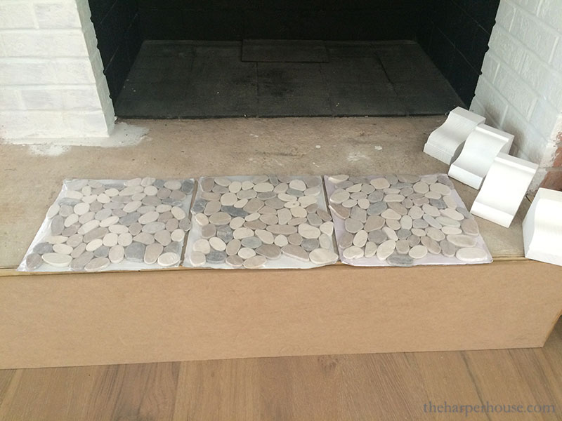 brick fireplace makeover using pebble stone mosaic tiles