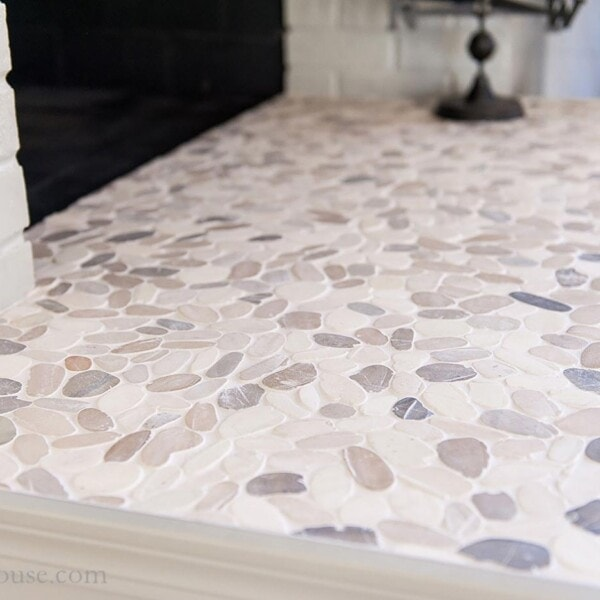 fireplace hearth tile using pebble stone mosaic tile