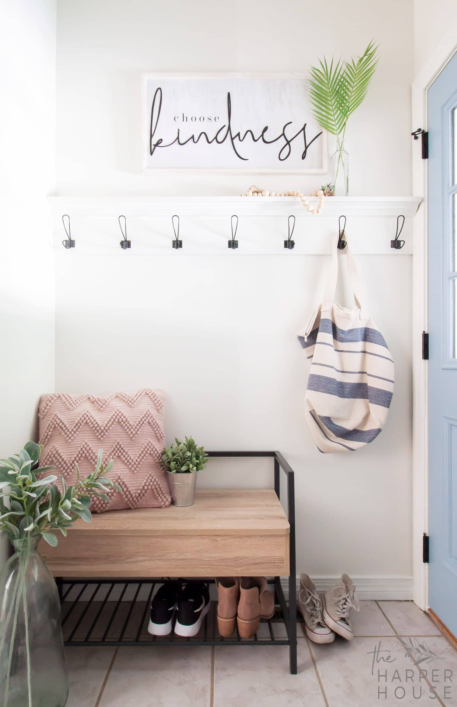 small laundry room ideas featuring a storage bench and diy coat hooks