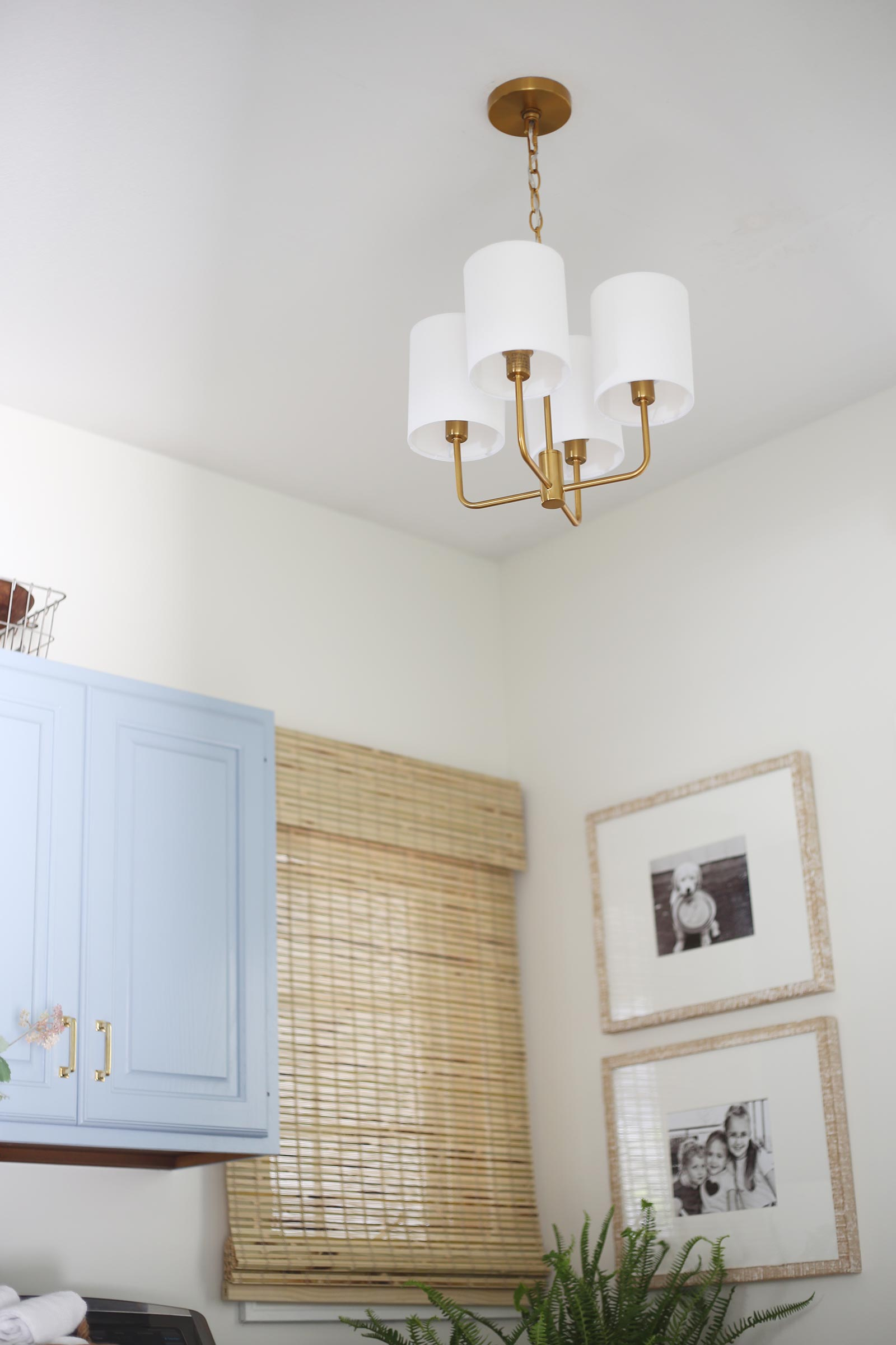 modern brass light fixture in laundry room