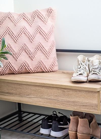 pink chevron pillow on storage bench