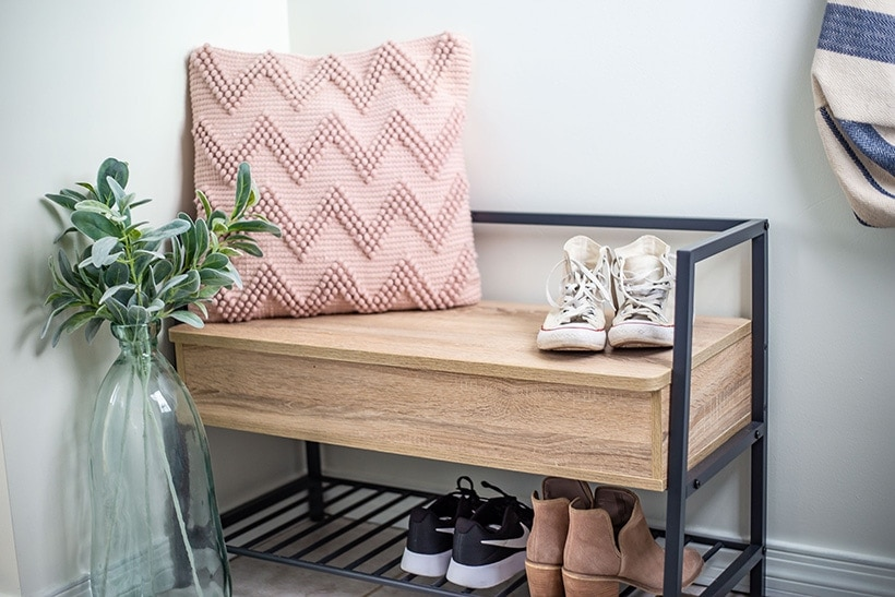pink chevron pillow on storage bench