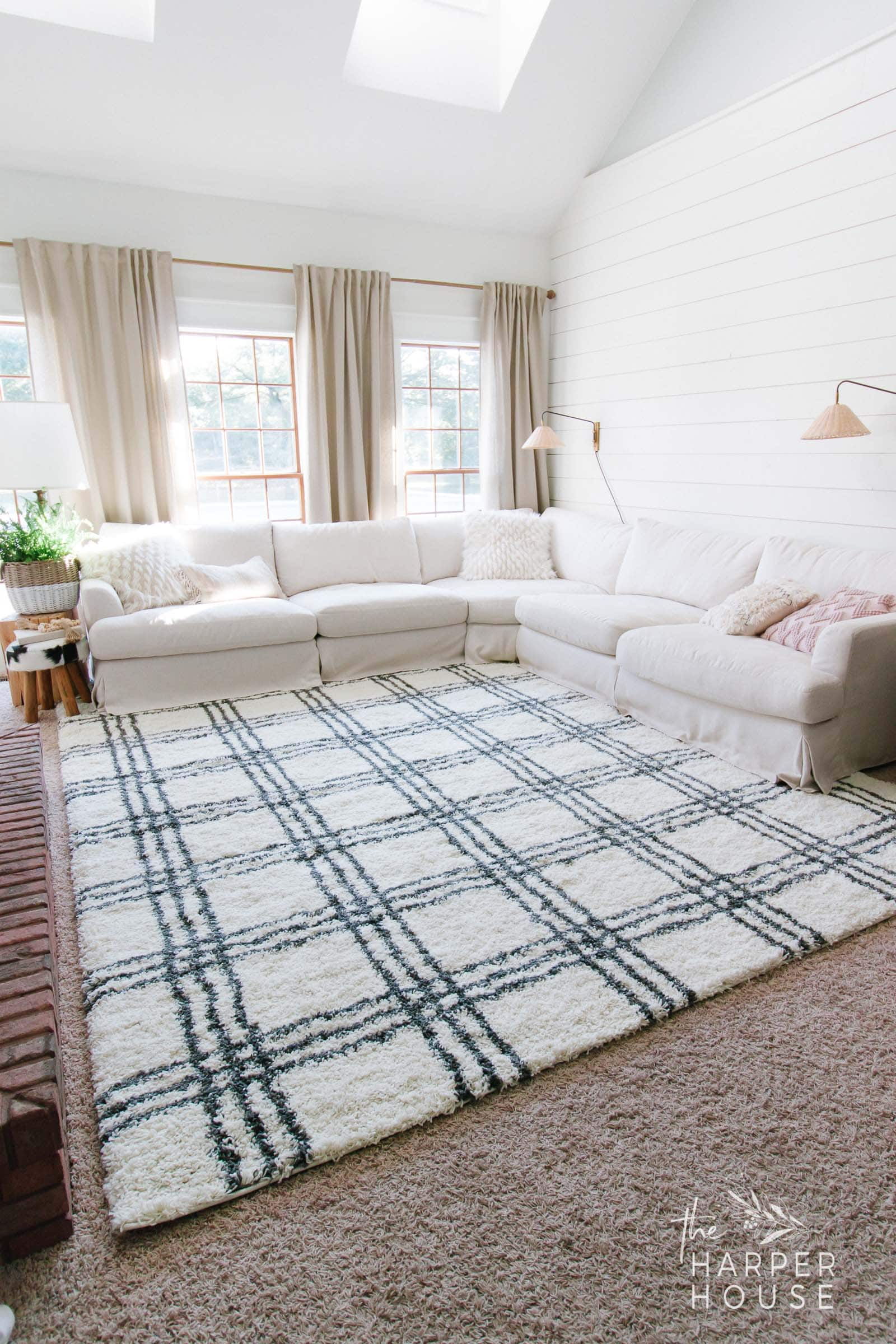 black and white rug layered over carpet