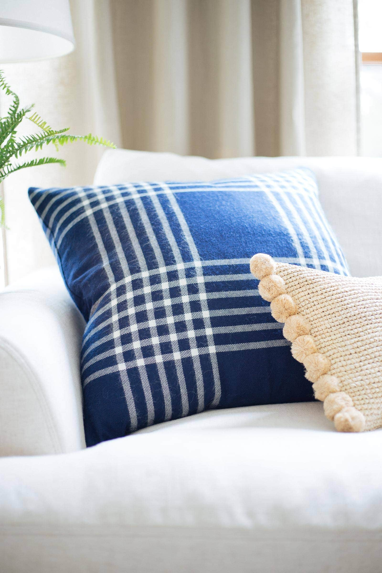 blue plaid pillow and rattan lumbar pillow from Serena & Lily