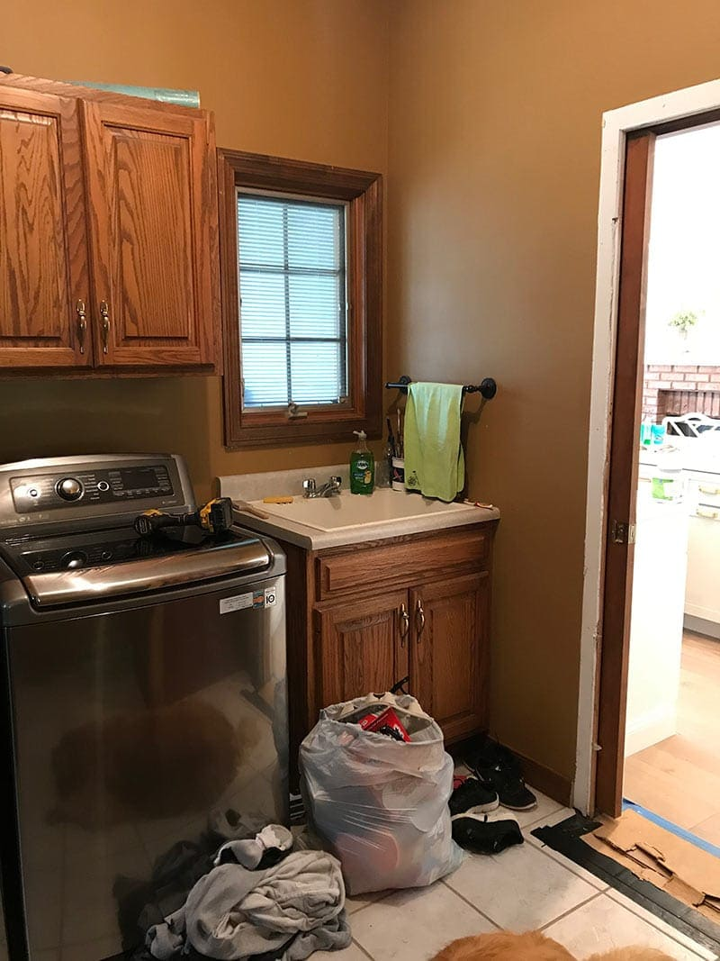 laundry room before pic: dark and dreary