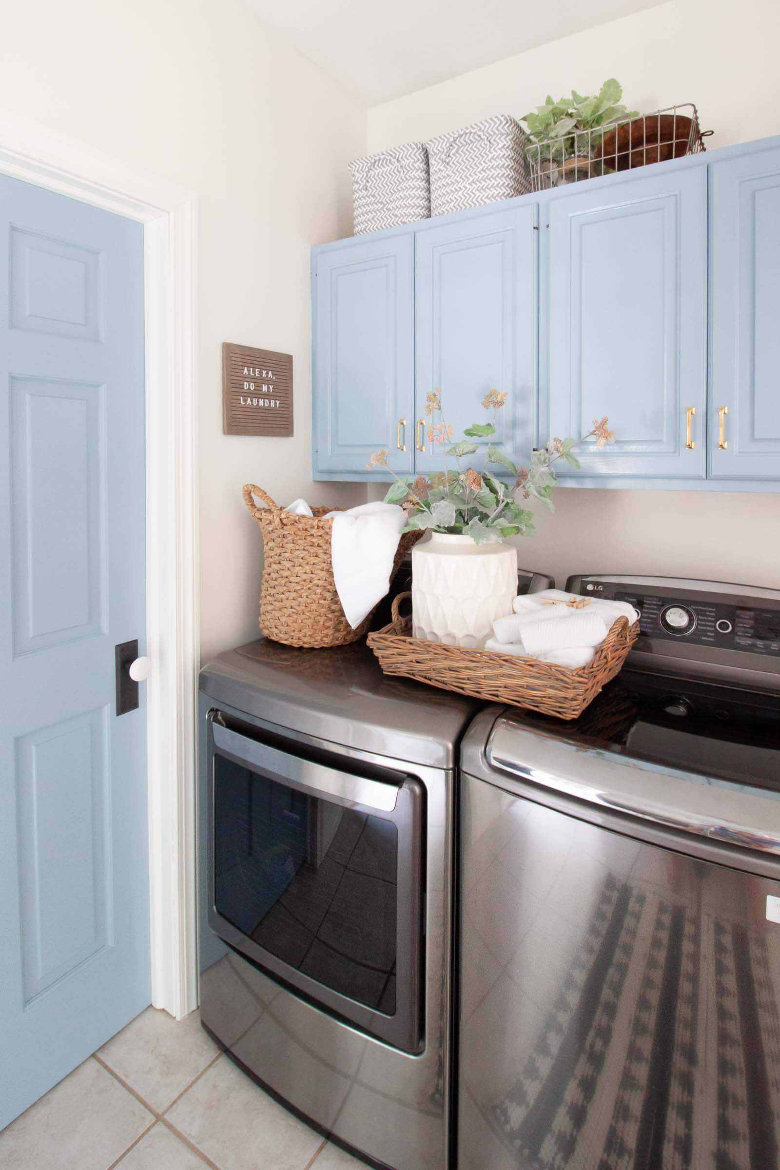 blue laundry room cabinets and blue interior door in laundry room