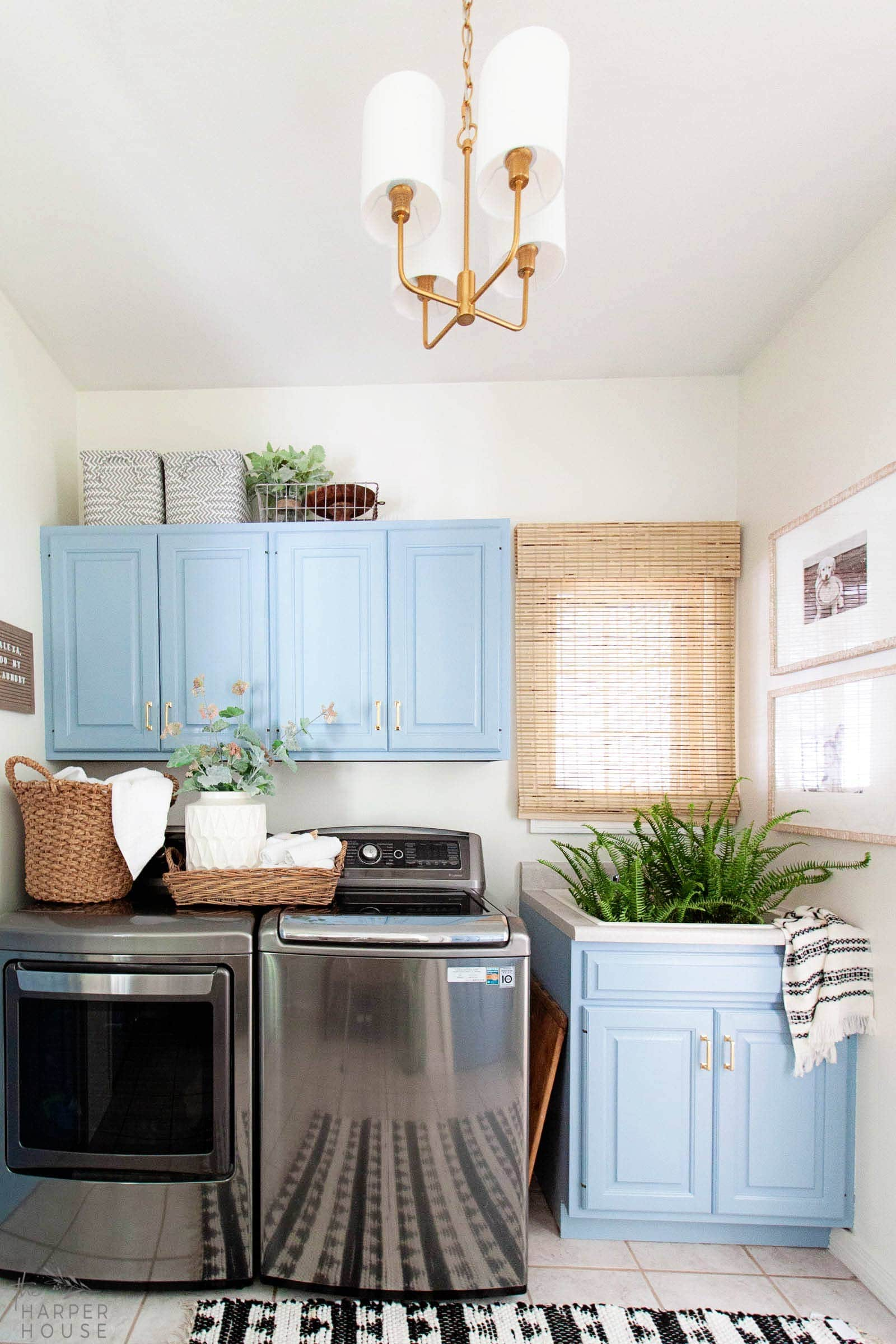 laundry room makeover featuring painted blue cabinets