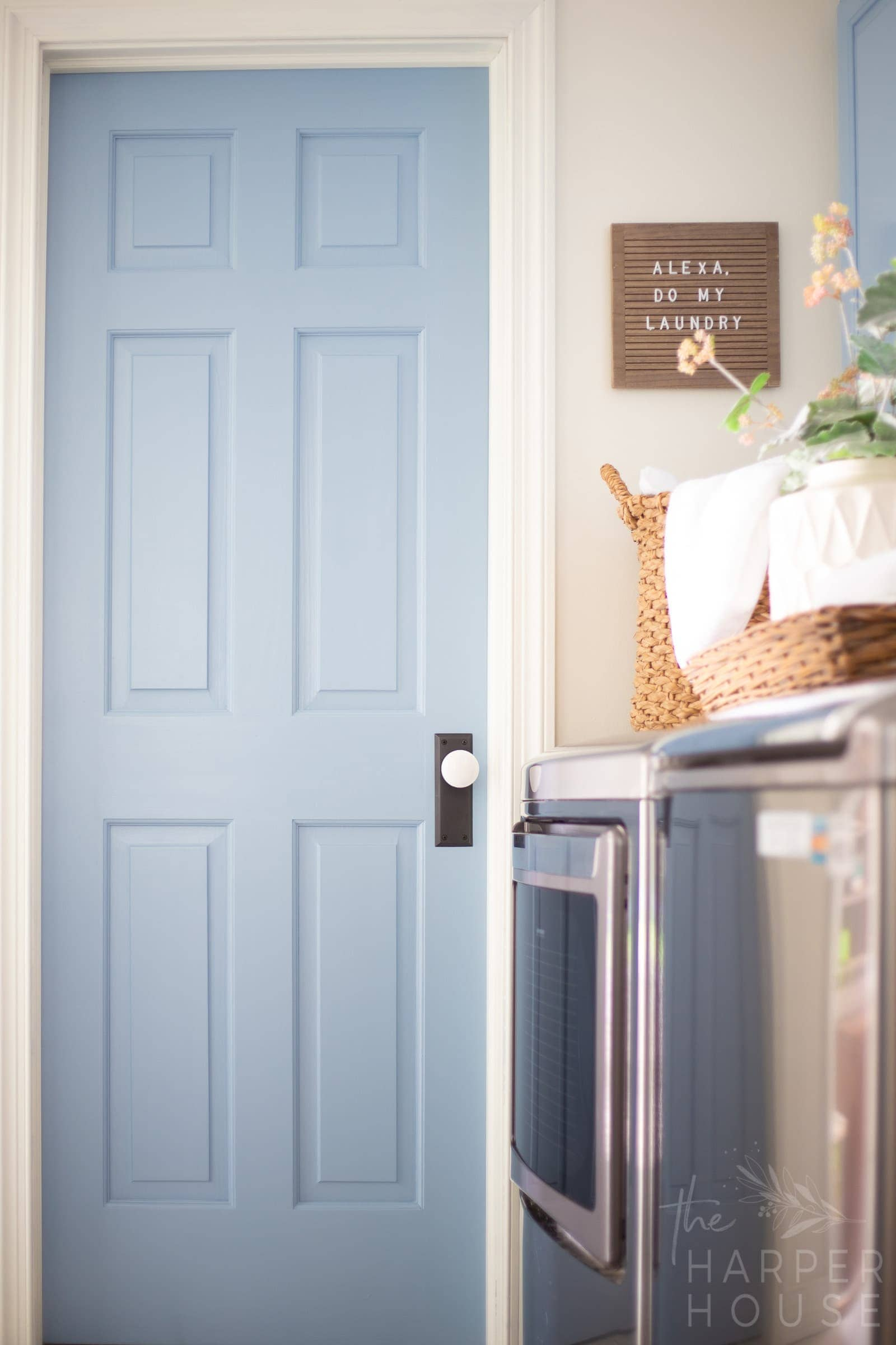 blue interior door with black and white door knob