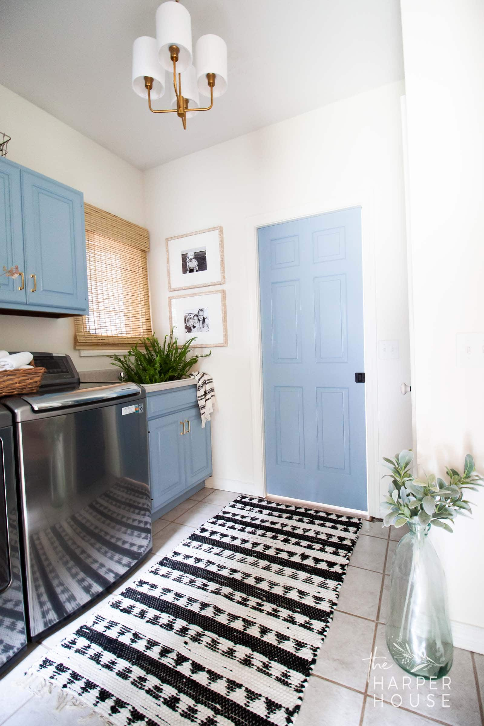 laundry room with blue cabinets