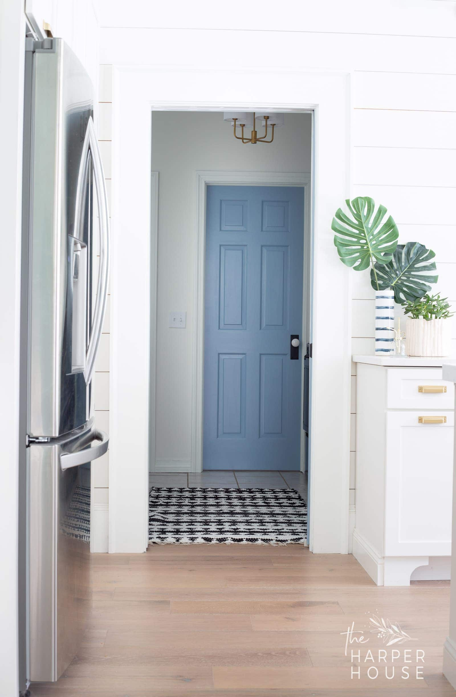 blue interior doors in laundry room makeover