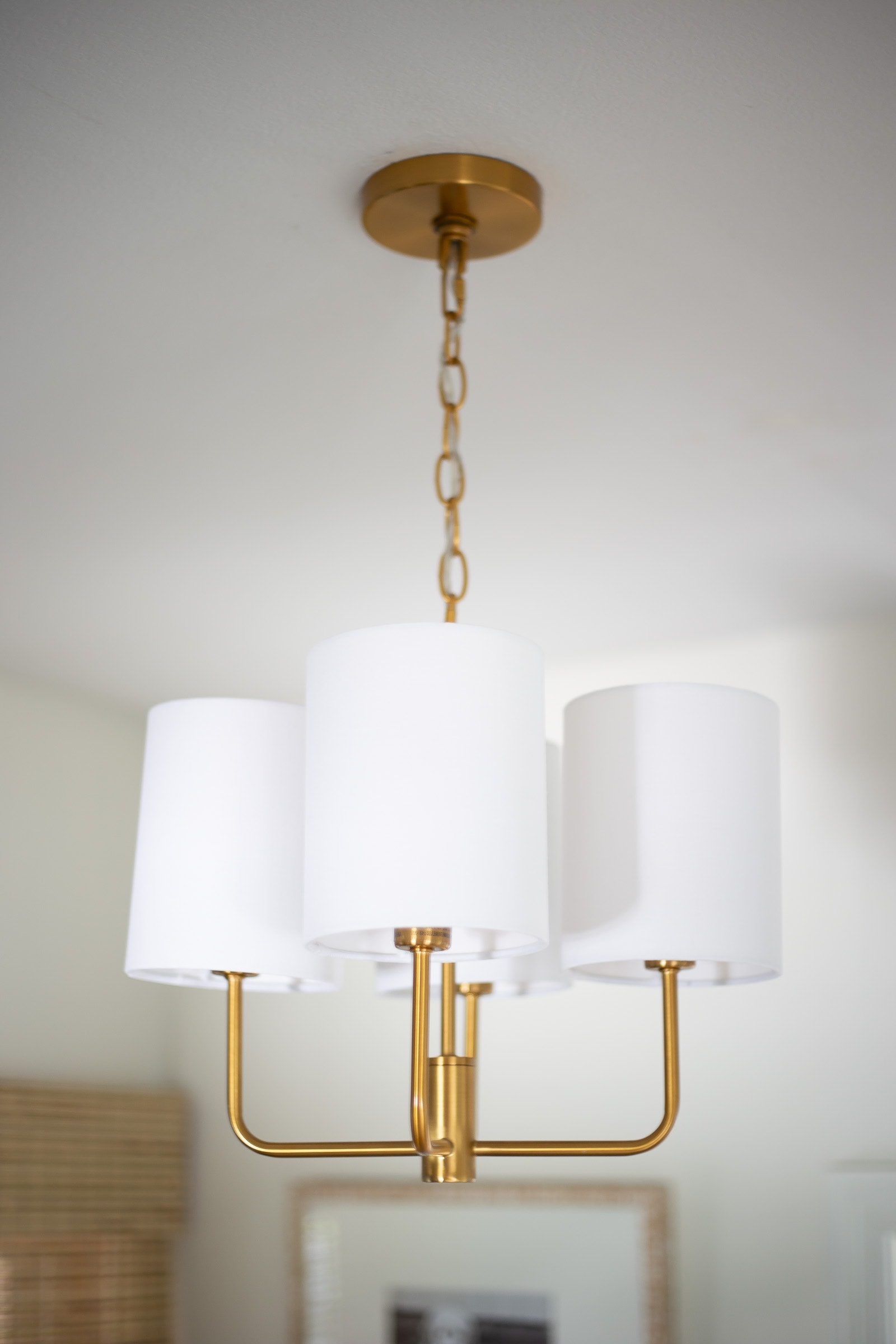 modern brass chandelier in laundry room