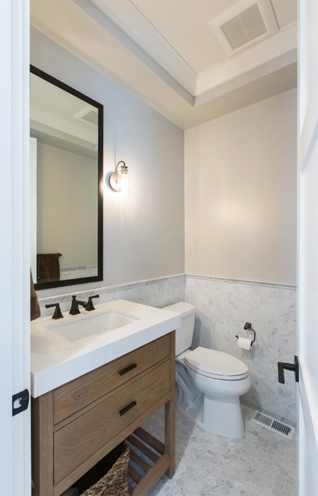 modern farmhouse bathroom with gray walls and marble tile SW Repose Gray SW 7015