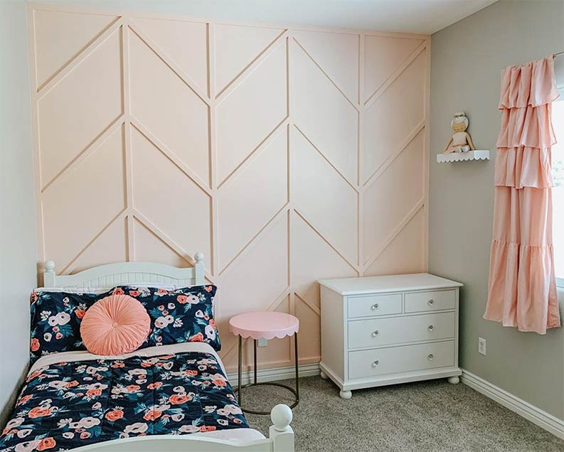 pink accent wall with Repose Gray walls in baby nursery