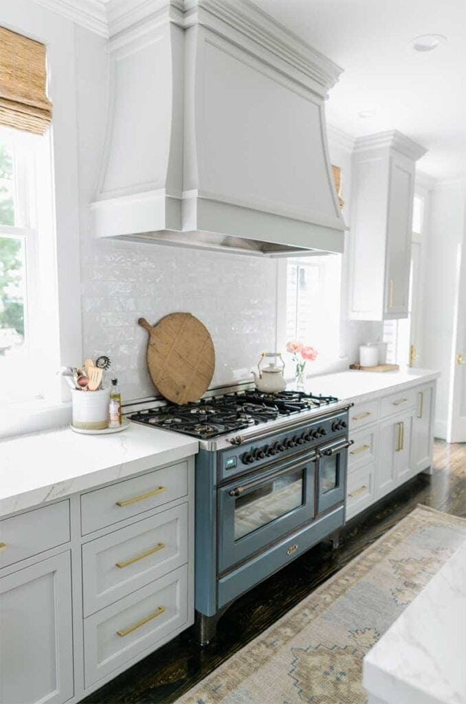 Grey kitchen cabinets with quartz countertops