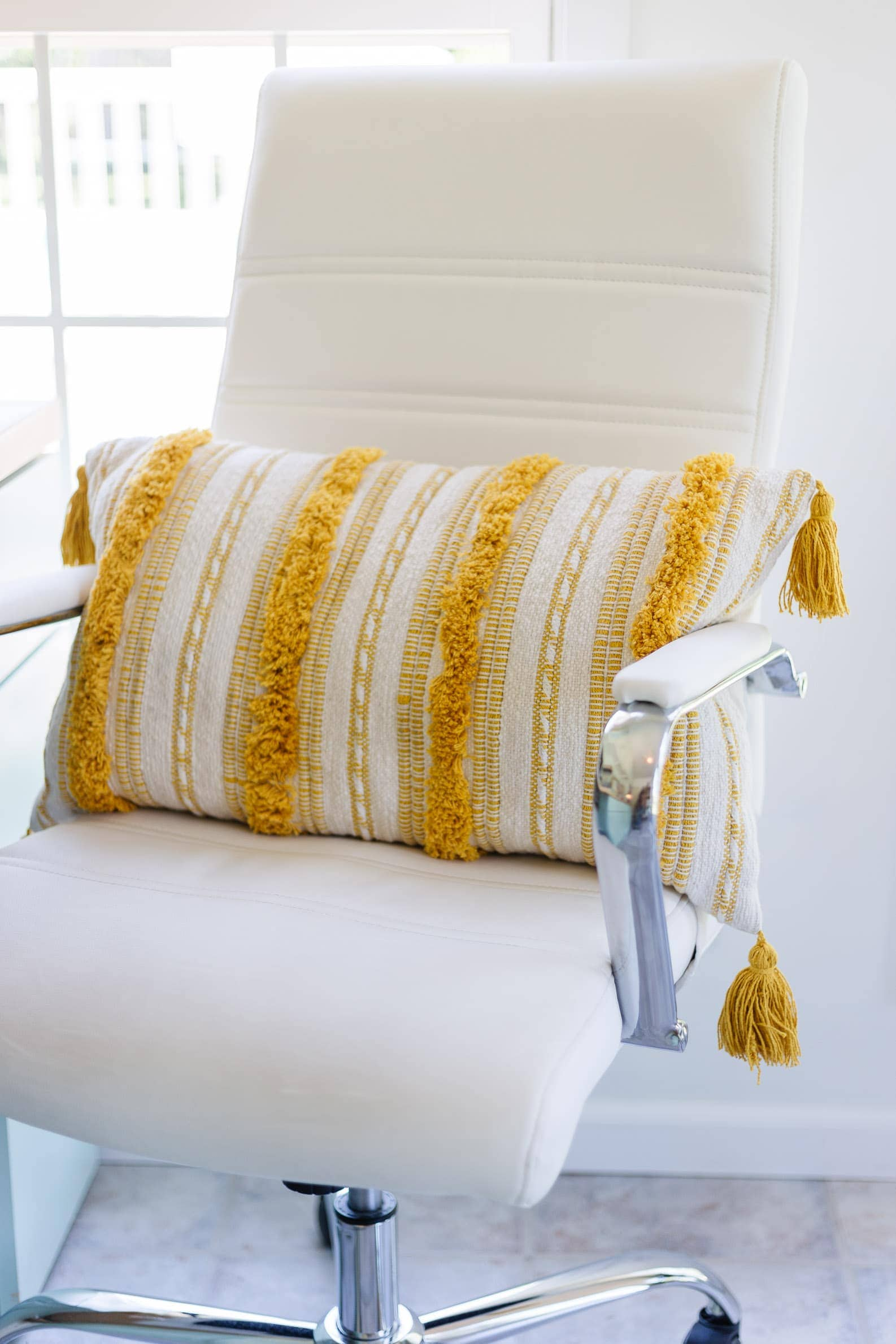 summer office decor featuring yellow striped lumbar pillow
