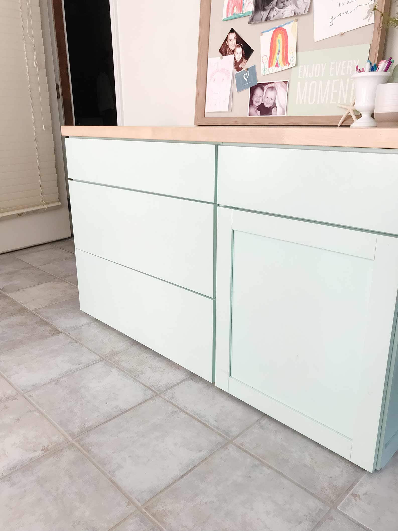 coastal office makeover featuring office decorating ideas and coastal decor. Teal aqua blue desk cabinets and diy butcher block desktop