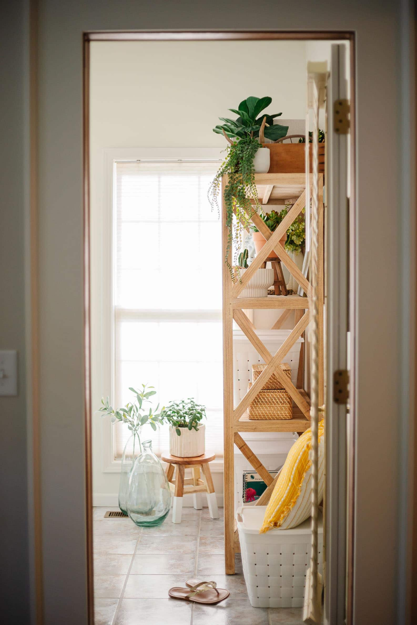 office storage ideas featuring wooden bookshelves and boho office decor