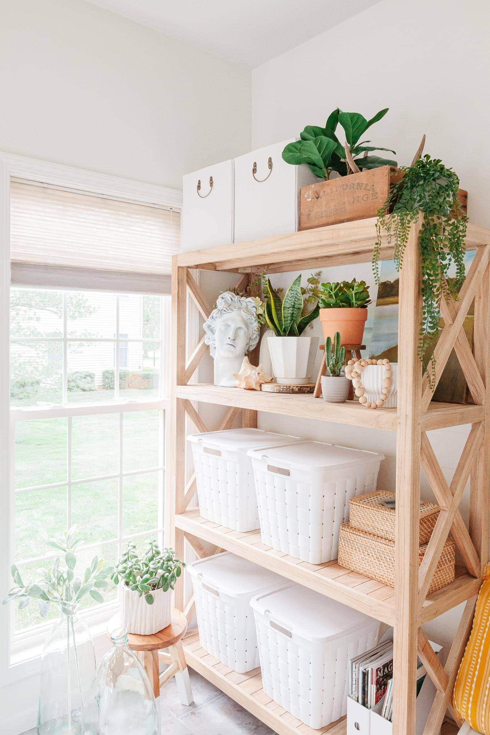 light and bright sunroom turned office space! Using natural light wood bookcase and shelves to store office supplies, home decor, and cute plants