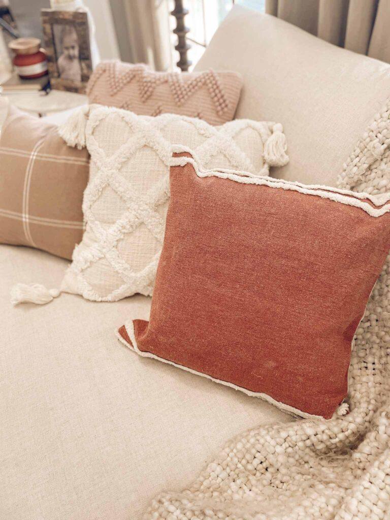 fall pillows on slipcovered sofa